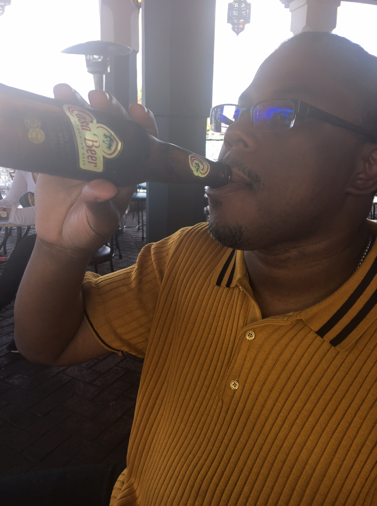 Aquil enjoying Moroccan Beer.JPG